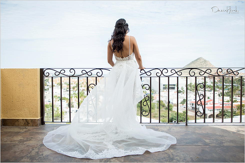 bride on balcony in wedding dress