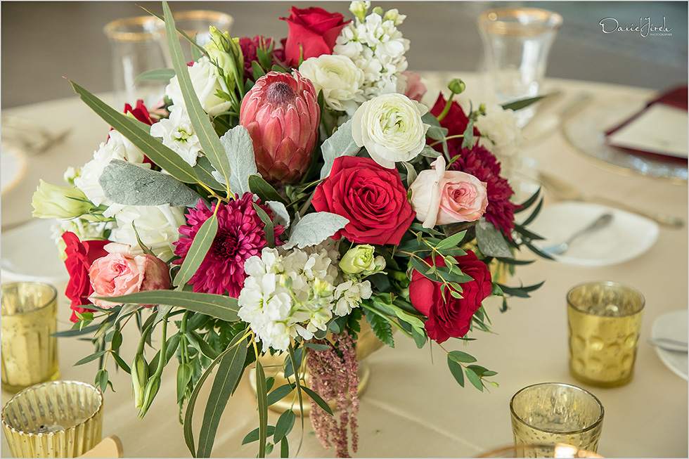 red cream and pink centerpiece with greenery