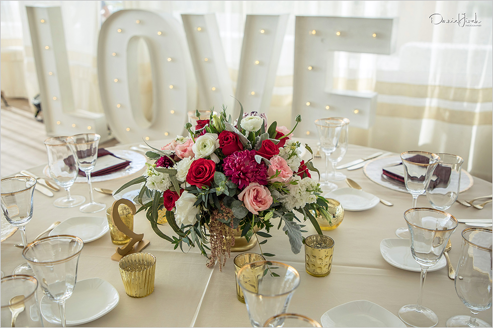 signage, red cream and pink centerpiece