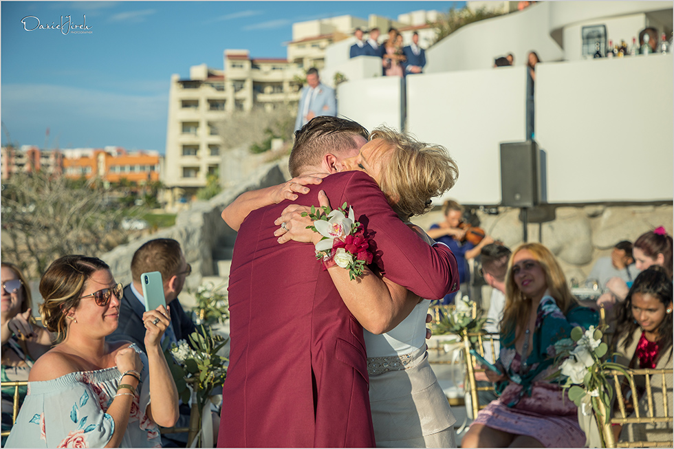 groom hugs mother