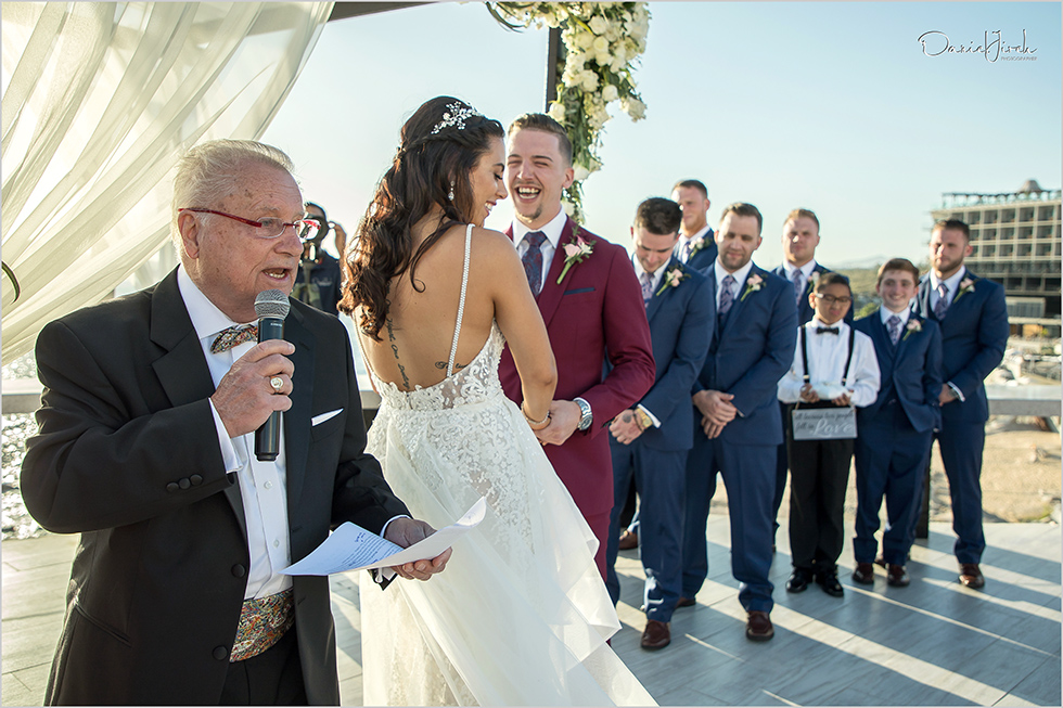groom laughs at wedding ceremony