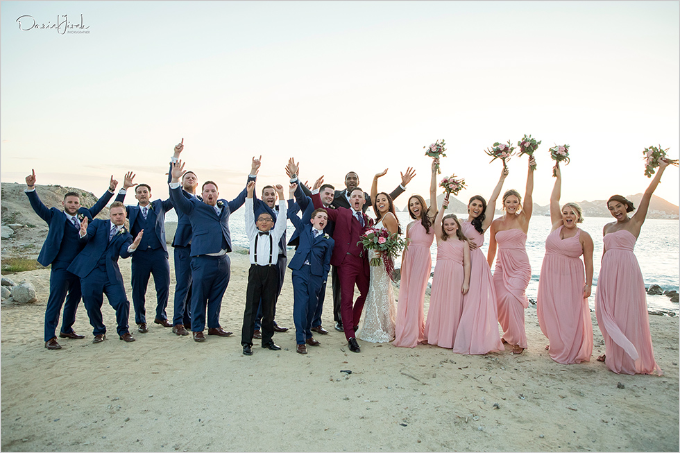 bride groom and bridal party on the beach
