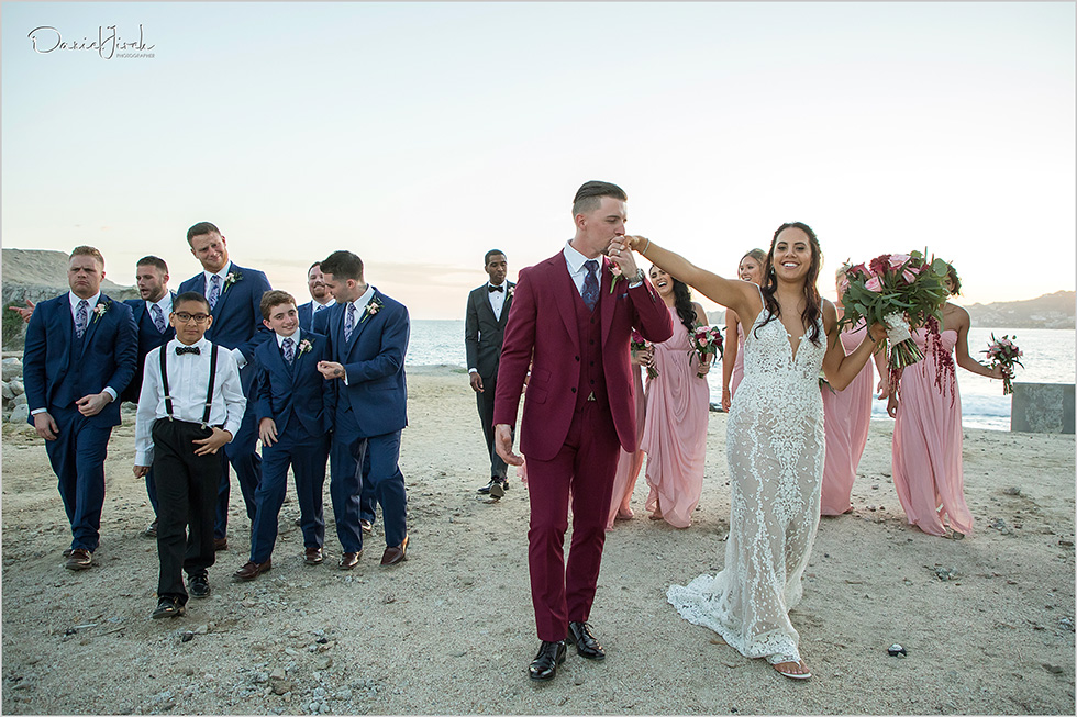 bride groom and bridal party on beach