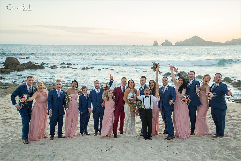 bride groom and bridal party having fun on beach