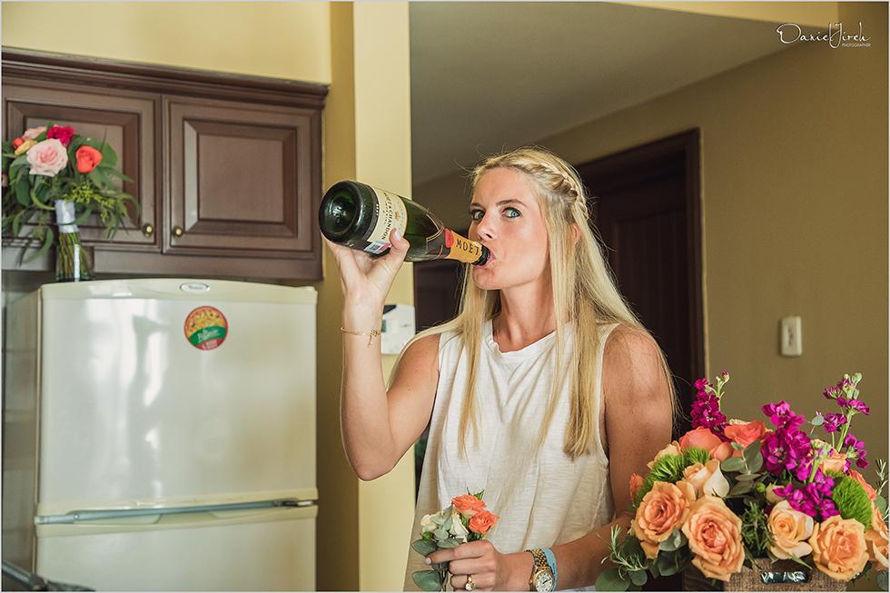bridesmaid drinking champagne at Los Cabos wedding