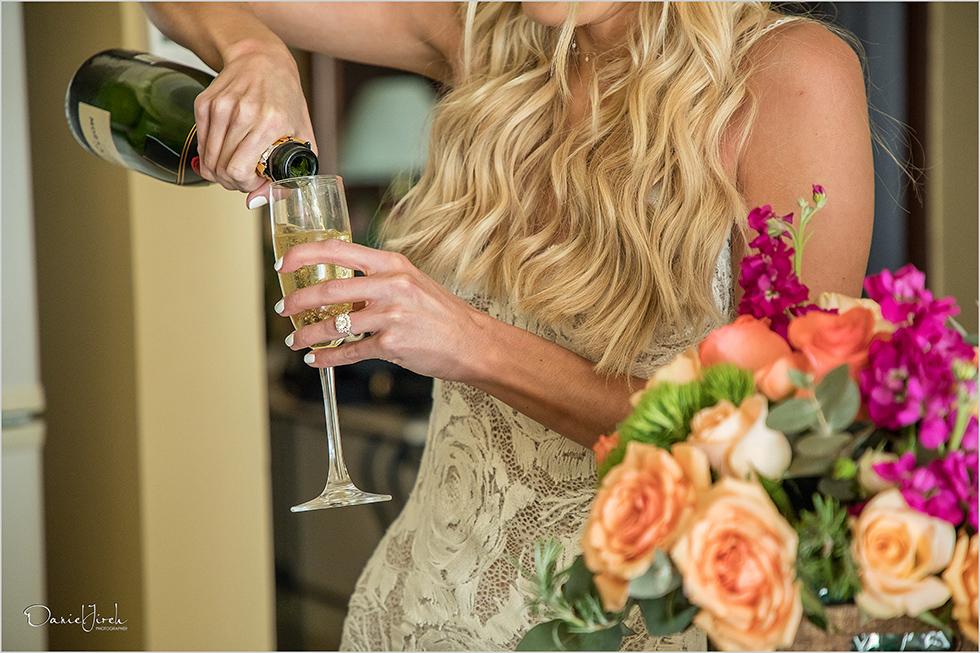 bride drinking champagne at Los Cabos wedding