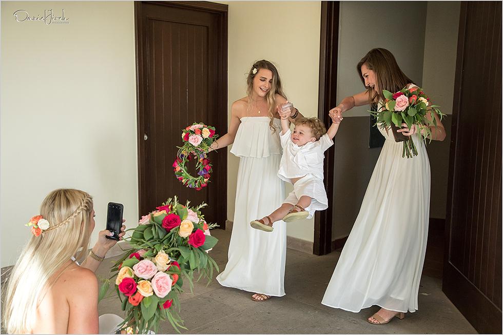 bridesmaids play with child at Los Cabos wedding