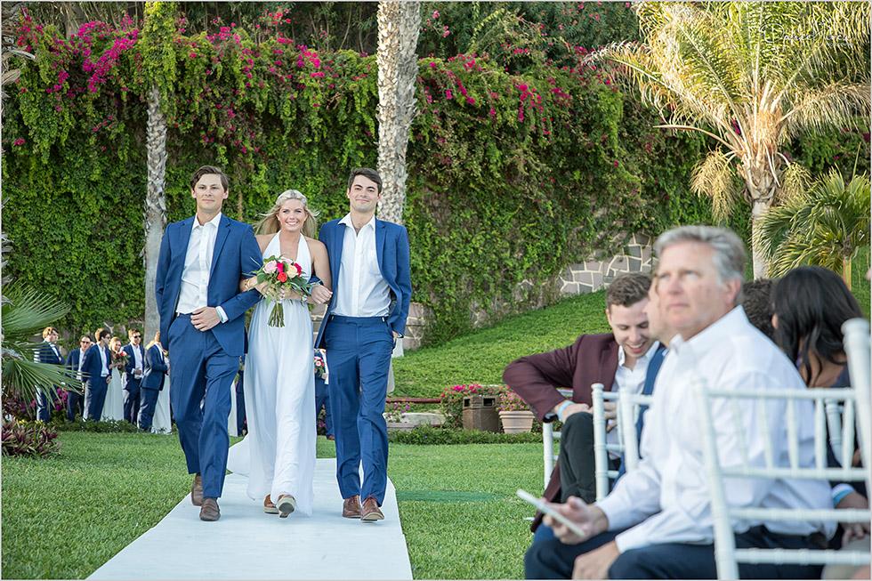 bridal party walk down the aisle at Pueblo Bonito Sunset Beach