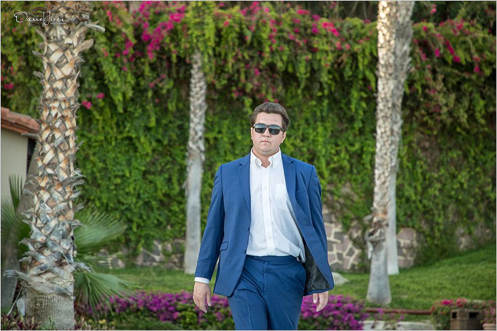 groomsman walks down the aisle at Pueblo Bonito Sunset Beach