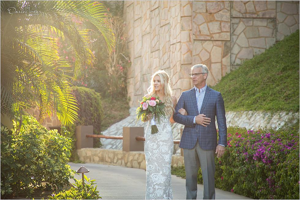 bride and father walk down the aisle at Pueblo Bonito Sunset Beach