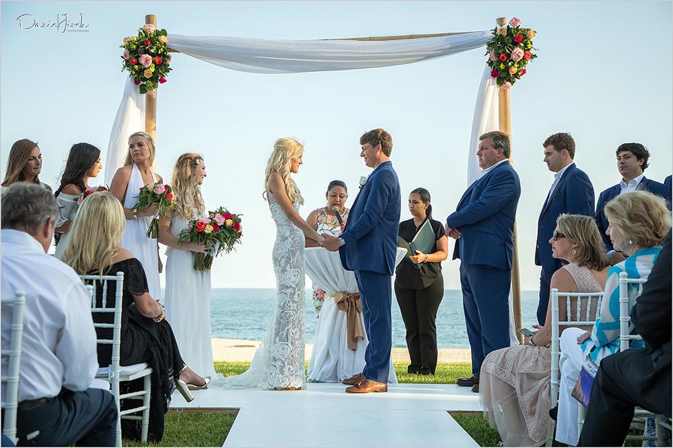 bride and groom hold hands at Los Cabos wedding ceremony