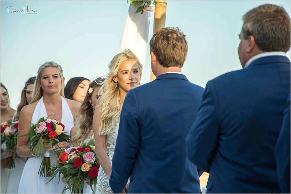 Bride and groom share vows during wedding ceremony at Pueblo Bonito Sunset Beach