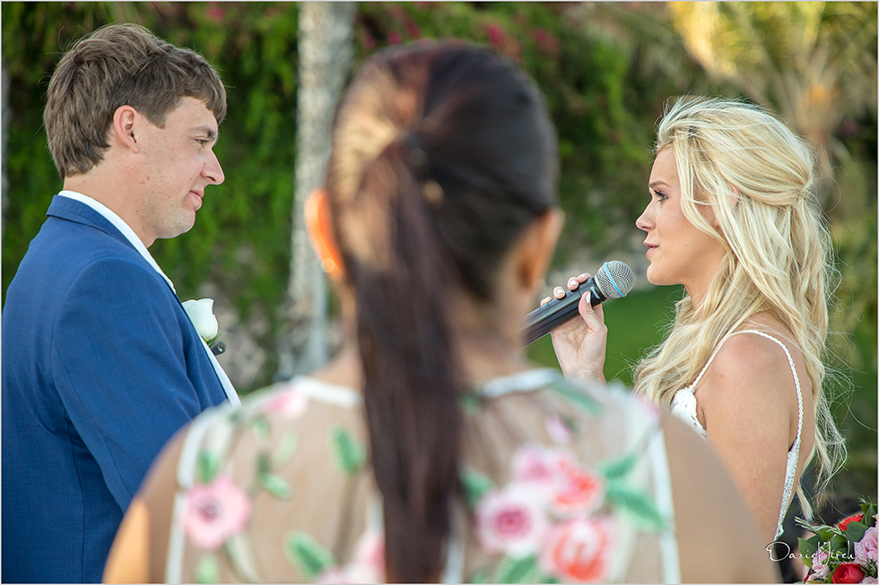 bride and groom share vows during ceremony in Cabo