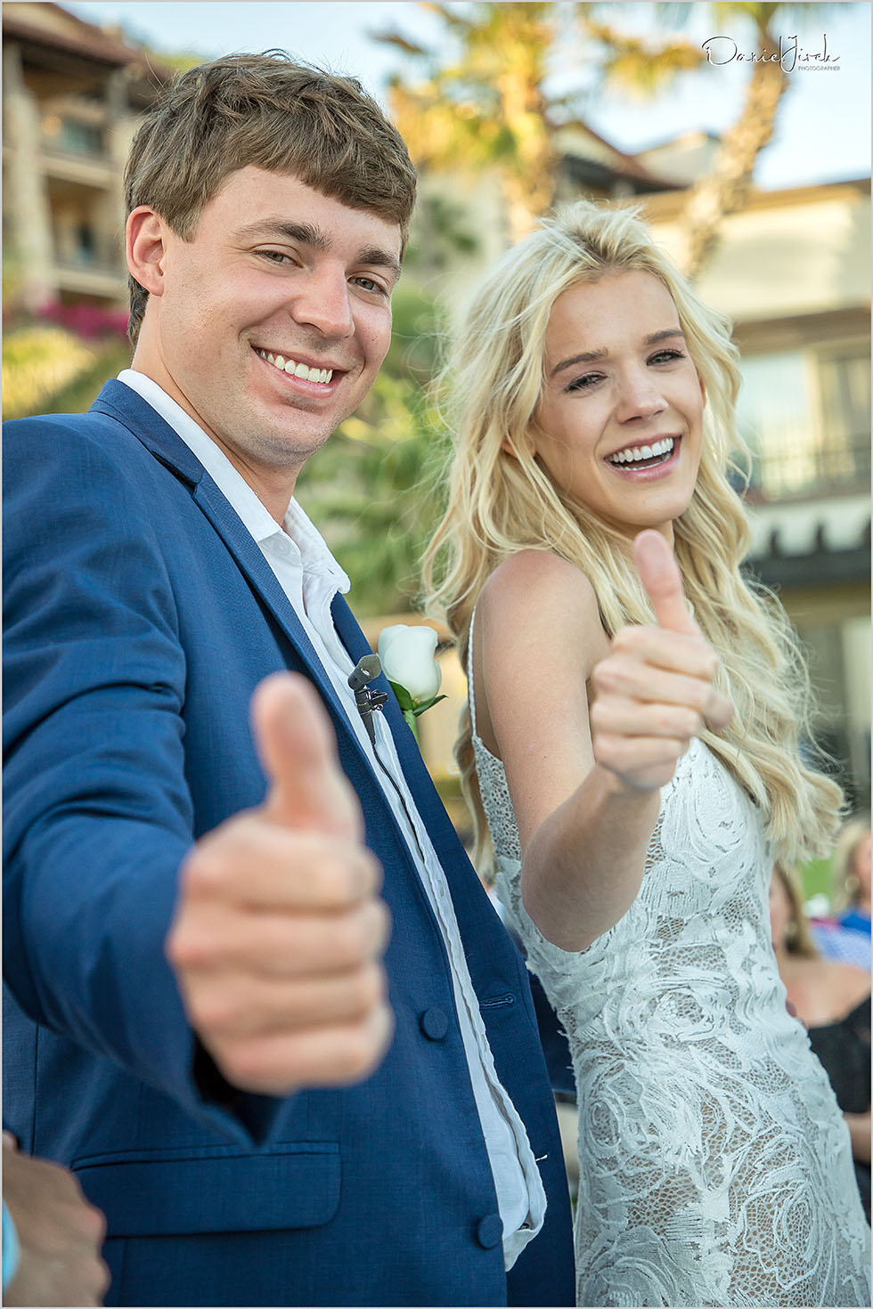 bride and groom give thumbs up