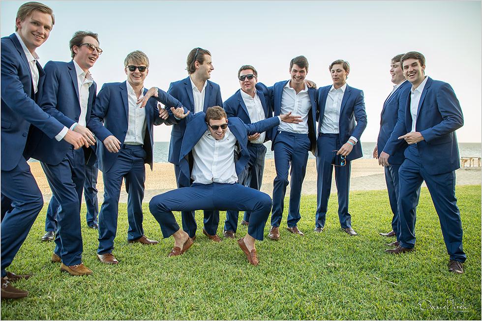 groomsmen dance and have fun at Los Cabos wedding