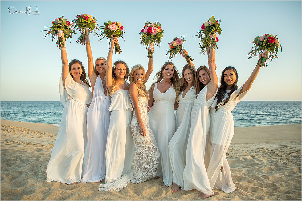 bridesmaids and bouquets on the beach