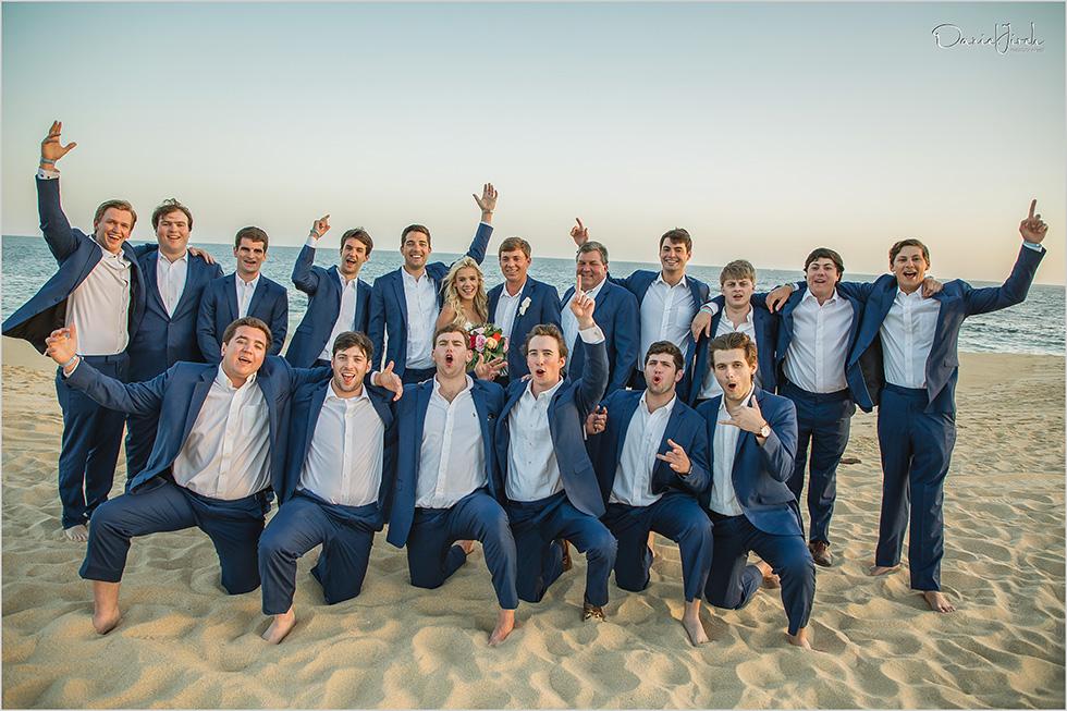 bride groom and groomsmen on the beach