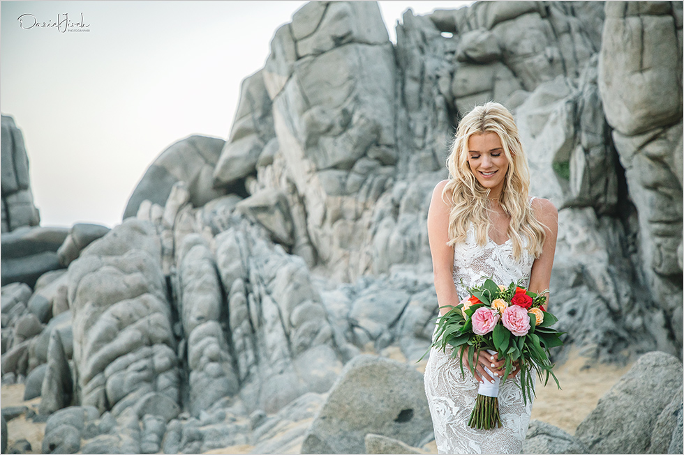 bride holding colorful bouquet on beach in Los Cabos