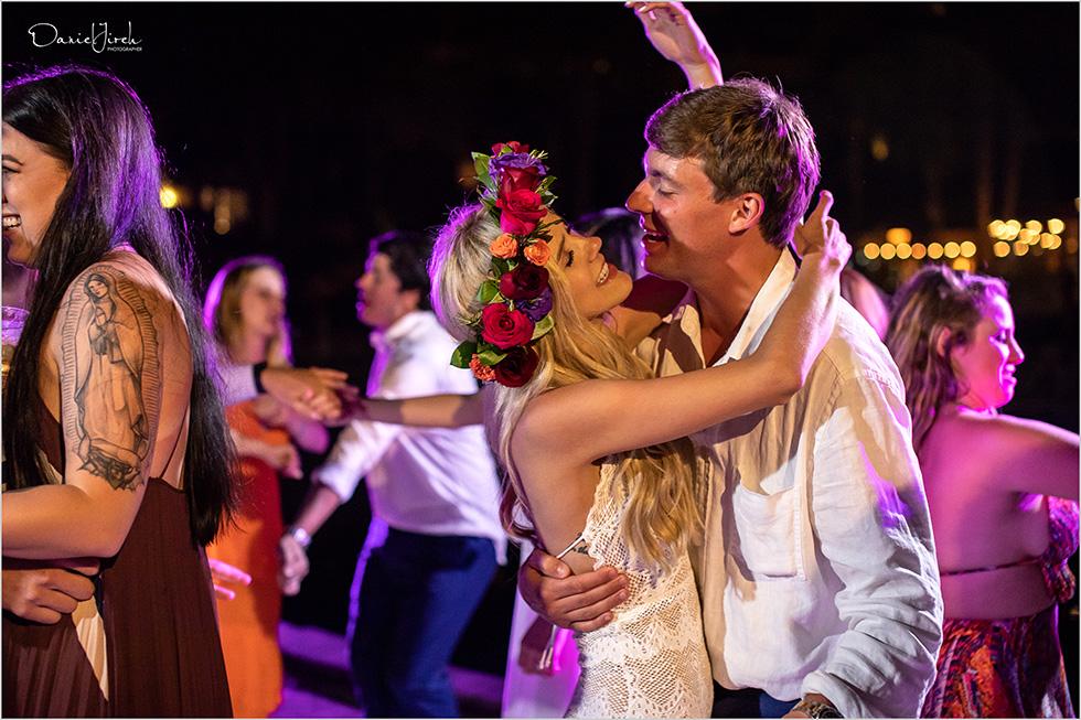bride and groom dance at wedding, flower crown