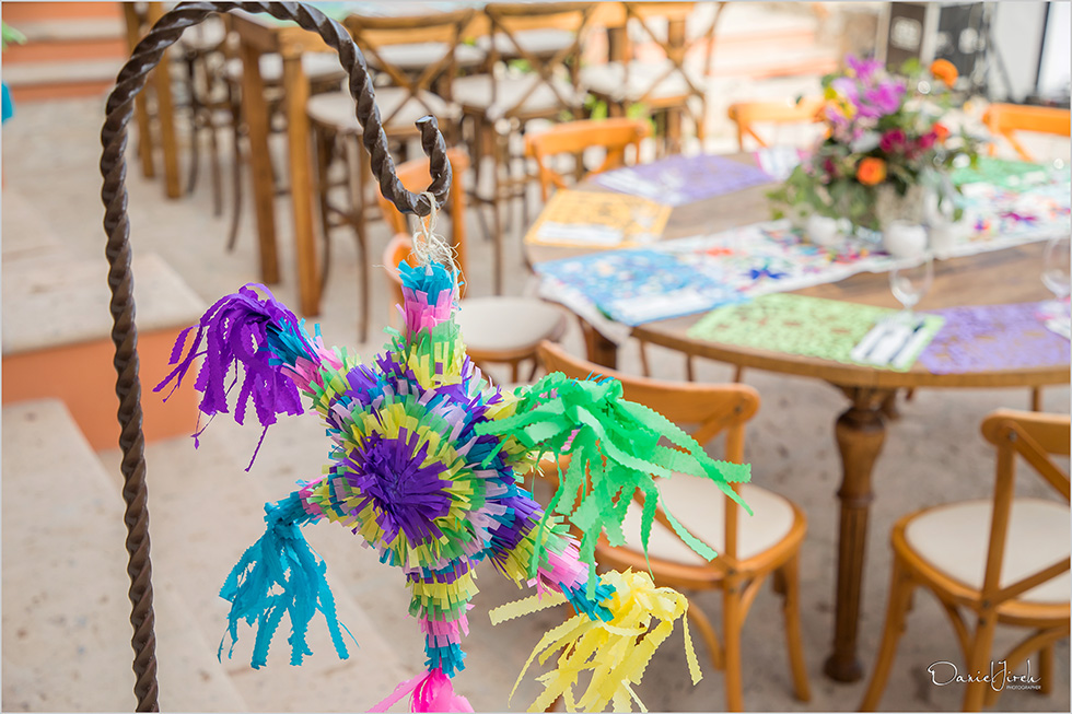 colorful piñata and tablescape with Mexican theme