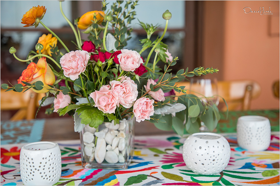 Floral centerpiece and colorful runner with white tealights