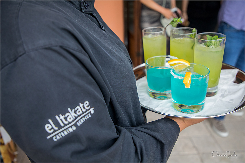 waiter serves colorful cocktails