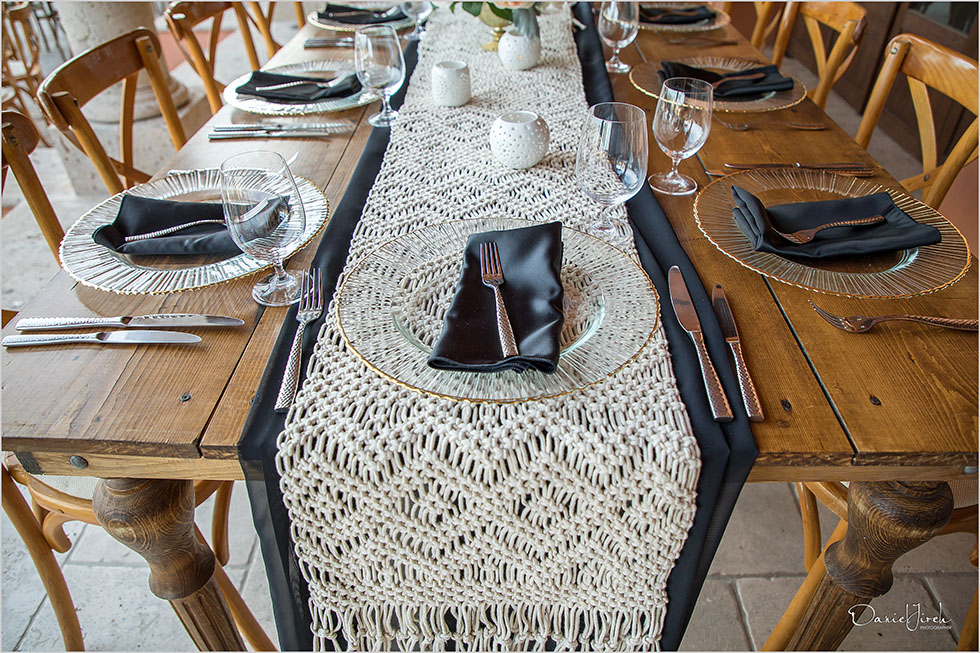 gold charger, black napkin, rustic table