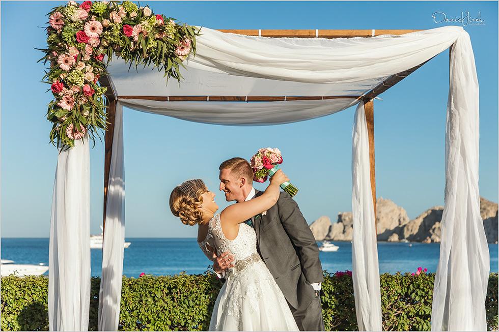 Cabo wedding photography Casa Dorada, destination wedding ceremony, just married, Land's End ceremony, beachfront wedding