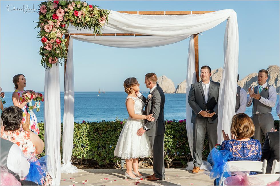 Cabo wedding photography Casa Dorada, destination wedding ceremony, bridal party, first kiss